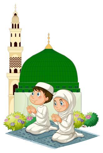 Två muslimska barn ber i moské