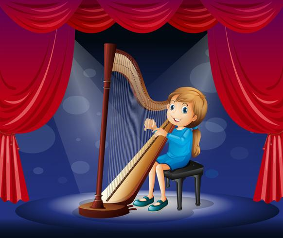 Little girl playing harp on stage