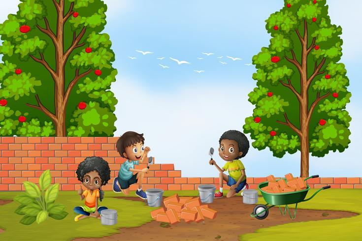 Drie kinderen gelaagdheid bakstenen in de tuin
