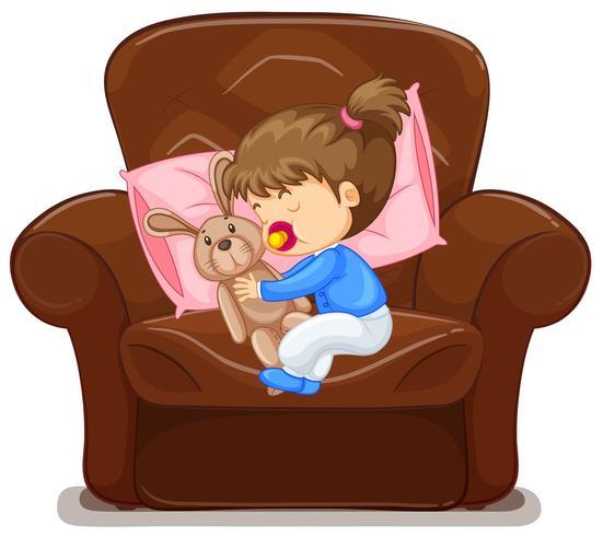 Kind schläft im Sessel