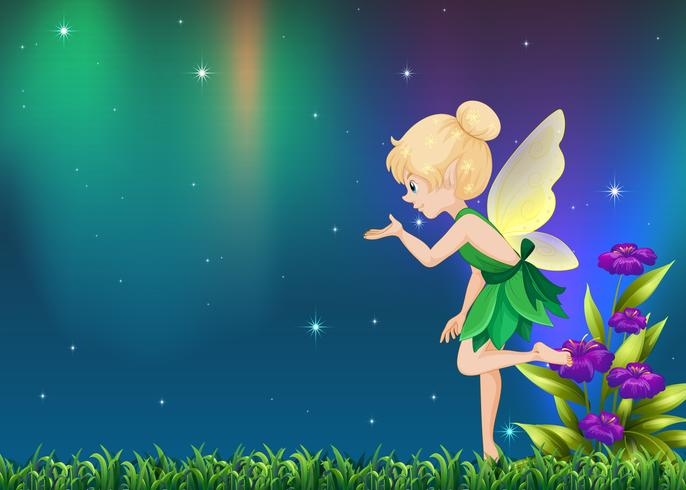 Cute fairy flying in garden at night