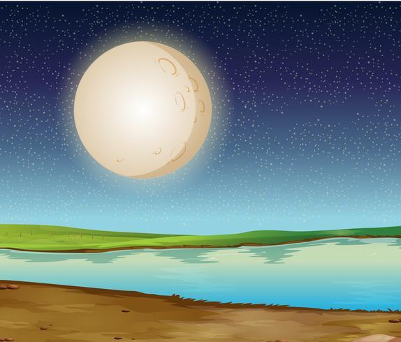 Scène met volle maan over de rivier
