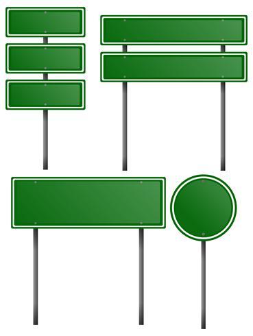 Sinais verdes em postes de metal