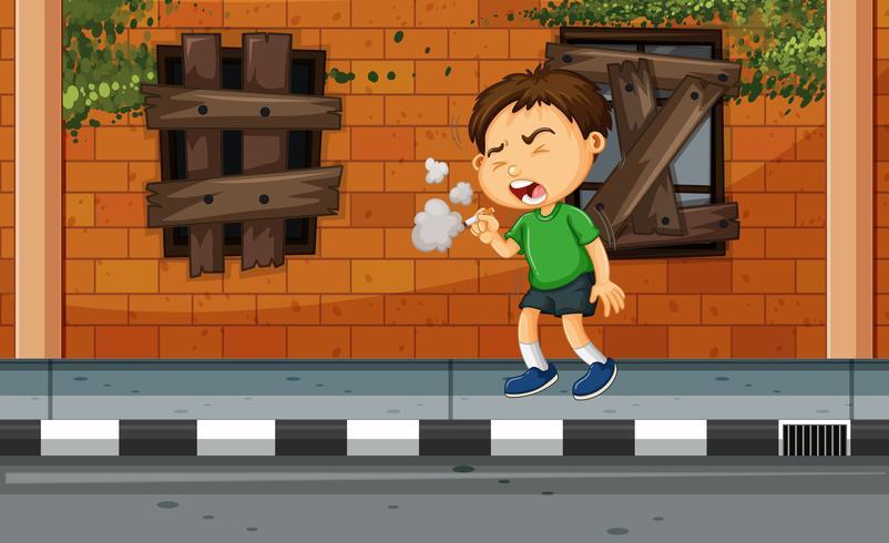 Junge, der auf der Straße raucht