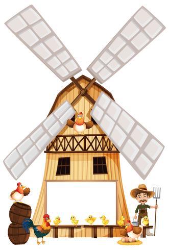 Agricoltore e galline sul mulino a vento