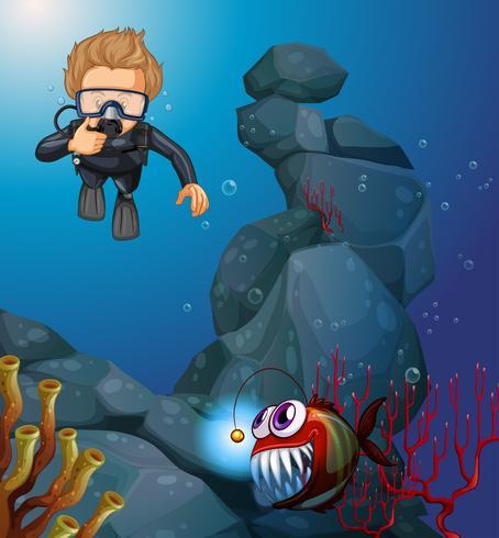 Dykare dykning i djupblå havet