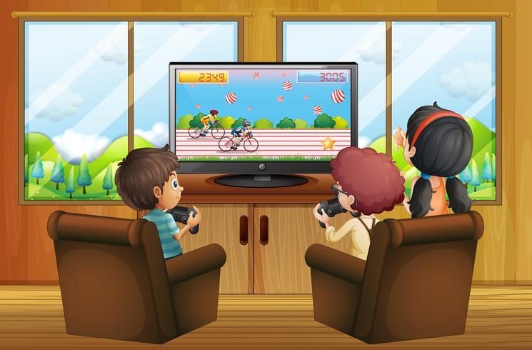 Tre barn leker vdo spel i rummet