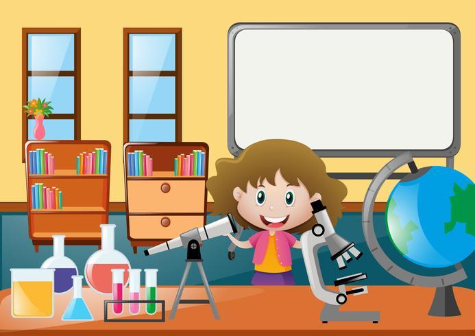 Chica y diferentes epuipments de ciencia en el aula.