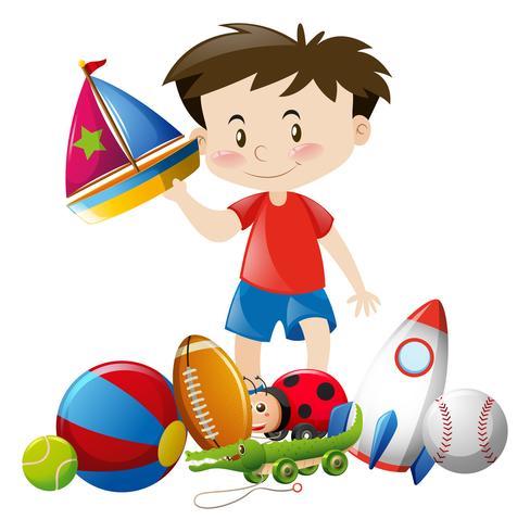 Pojke leker med många leksaker