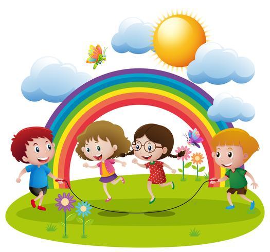 Fyra barn hoppar rep i trädgården