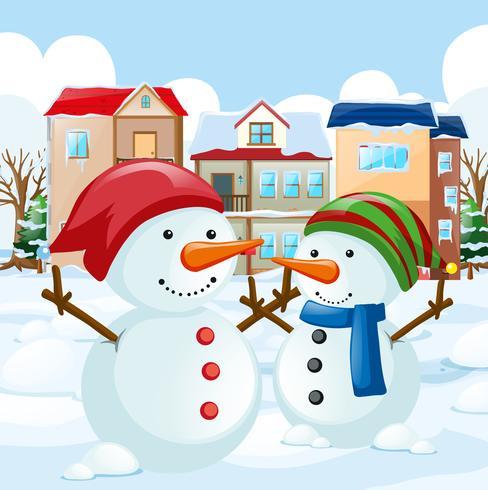 Two snowman in the field