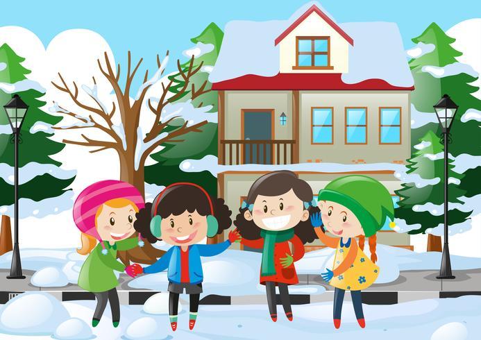 Vier Kinder in der Winterkleidung, die auf der Straße steht