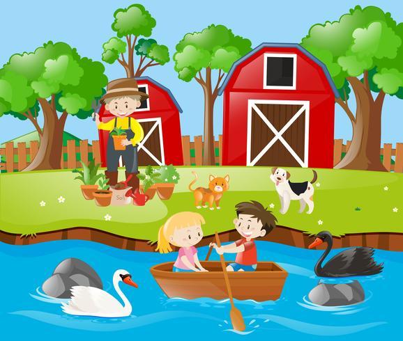 Crianças a remo de barco no rio