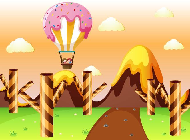 Terra fantastica con palloncino di caramelle e waffle