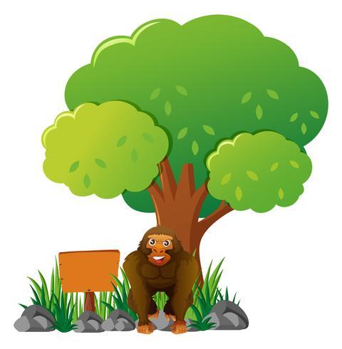 Träskylt och gorilla i trädgården