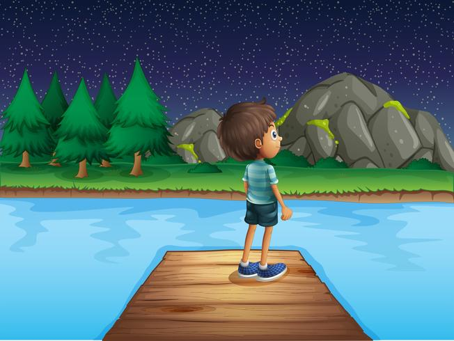 Pojke tittar på stjärnorna på natten