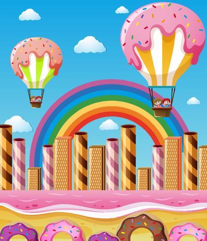 Scena con bambini che volano in palloncini di caramelle