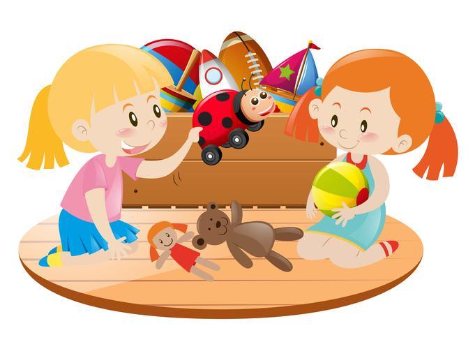 Två tjejer leker med leksaker i rummet