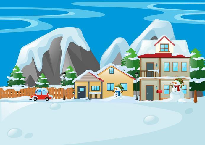 Scena con case e pupazzo di neve