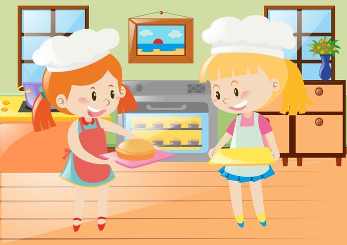 Zwei Mädchen, die Torte in der Küche backen