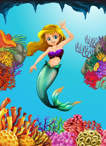 Linda sereia nadando debaixo d'água
