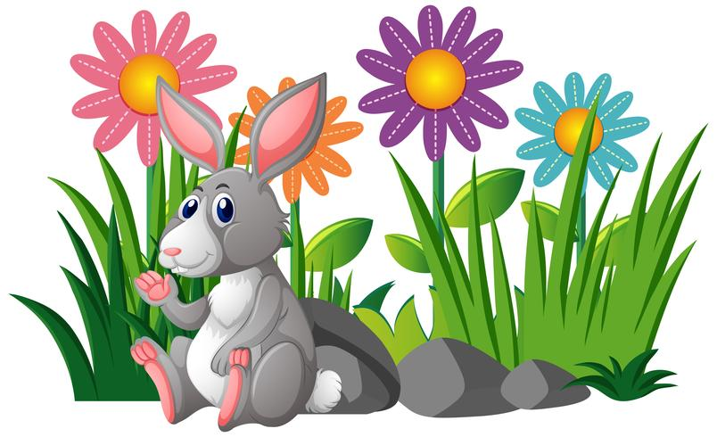 Cute rabbit in flower garden