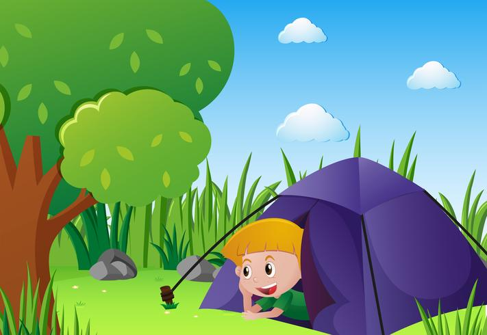 Little boy camping out in the park vector