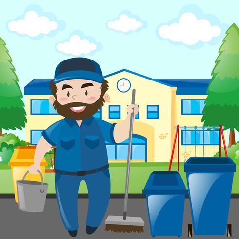 Concierge nettoyant le campus de l'école