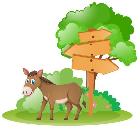 Trä tecken och åsna av trädet