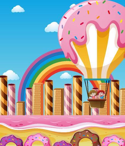 Kinder fliegen in Süßigkeiten Ballon