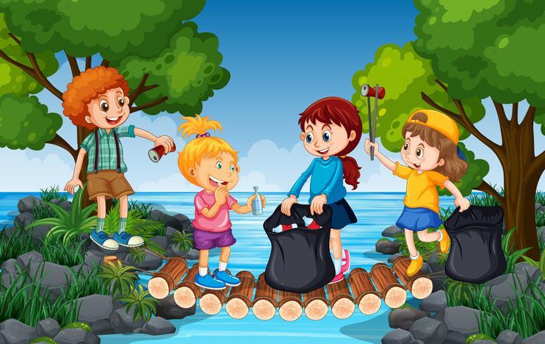 Kinder sammeln Müll neben dem Fluss