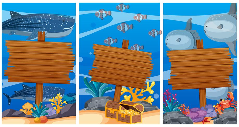 Wooden signs under the ocean with sea animals in background