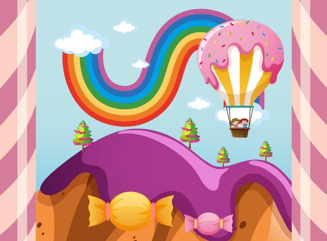 Scena con palloncino di caramelle sulle montagne viola