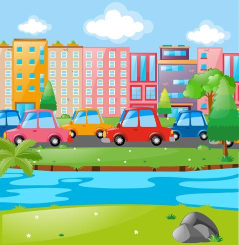 Escena de la ciudad con edificios y coches.
