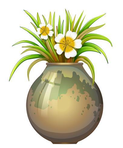 Ein großer Topfbehälter mit blühender Pflanze