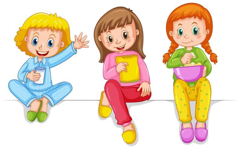 Tres chicas en pijama comiendo bocadillos