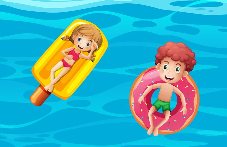 Children on pool floats