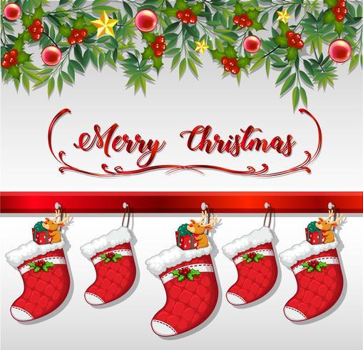 Tarjeta de Navidad con calcetines colgados en la pared