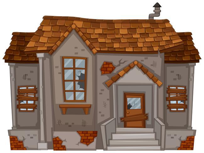 Vecchia casa con finestre rotte e porta