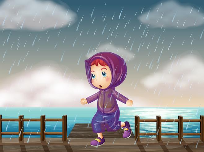 Ragazza che corre sotto la pioggia al molo