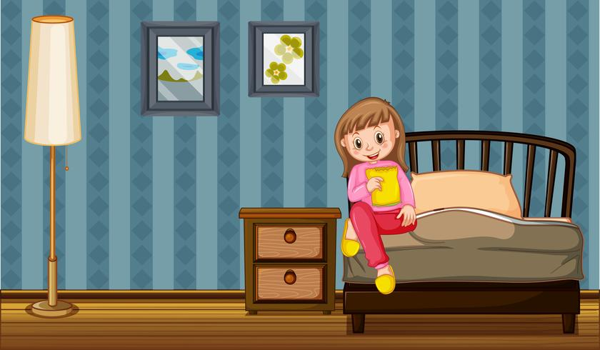 Meisje die snack in slaapkamer eten