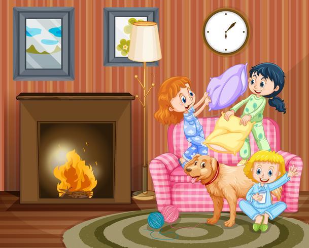 Drei Mädchen und Hund im Wohnzimmer