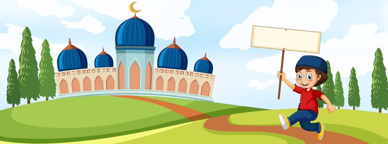 Un'insegna musulmana della tenuta del ragazzo davanti alla moschea
