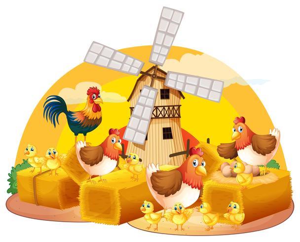 Kippen en kuikens op het hooi