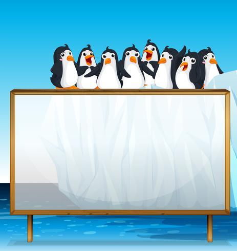 Marco de madera con pingüinos sobre hielo.