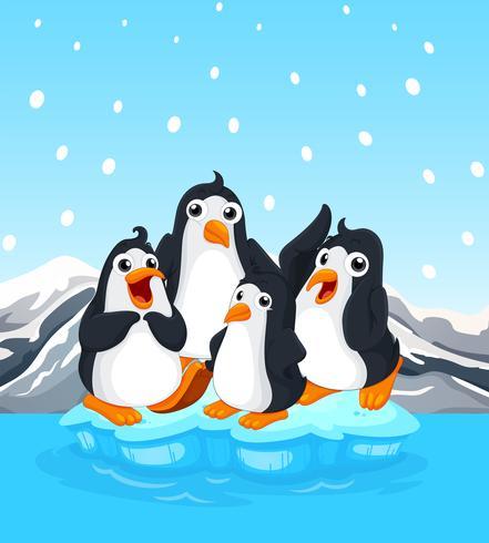 Cuatro pingüinos de pie en el iceberg
