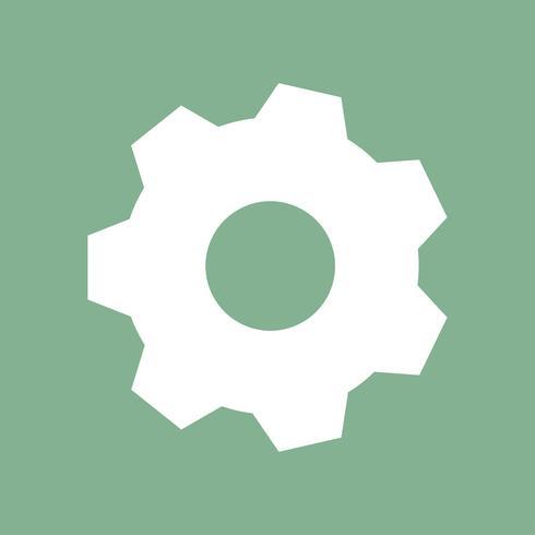 Engrenage blanc sur fond vert