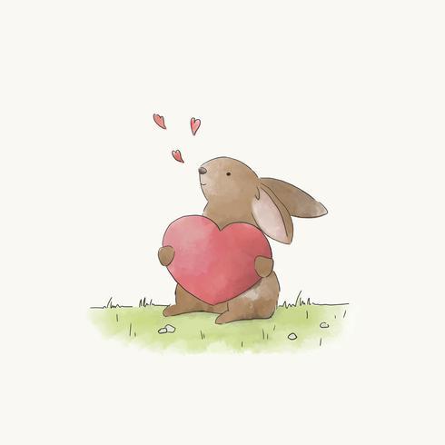 Coelhinho segurando um coração vermelho