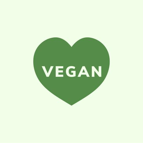 Das Wort Vegan in einem Herzformvektor