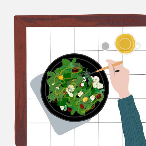 Persona che mangia un'insalata sana